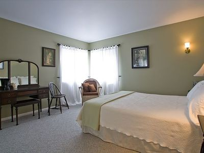This  first floor bedroom has an antique feel as well comfortable queen bed.