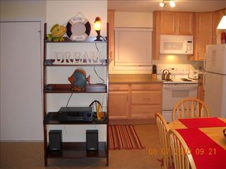 Folly Field condo photo - Kitchen, Dining Area, Bookcase / Stereo System, Front Door & Living Room on Left