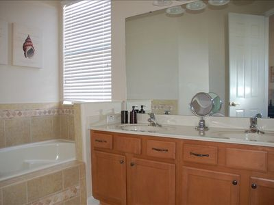 Reunion house rental - 5 piece ensuite masterbath, granite counters + dual shower heads. Soaker tub