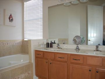 5 piece ensuite masterbath, granite counters + dual shower heads. Soaker tub