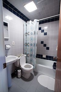 Tiled bathroom with all towels, shampoo, conditioner and blow drier provided.