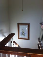 Tahoe Keys condo photo - staircase (with ceiling fan above) and painting