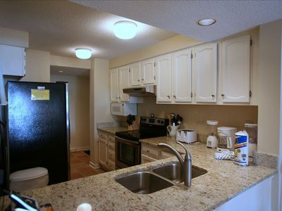 Stainless appliances and granite counter tops.