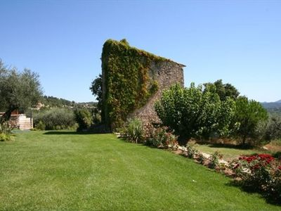 Lawns around the pool, and the 17th century castellane on the property