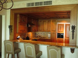 Nuevo Vallarta condo photo - Breakfast bar adjacent to main floor living/dining room.