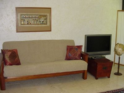 Comfotable Futon Couch and Plasma TV