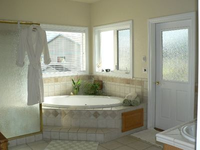 Our master bath is another great place to relax, door opens to a private patio