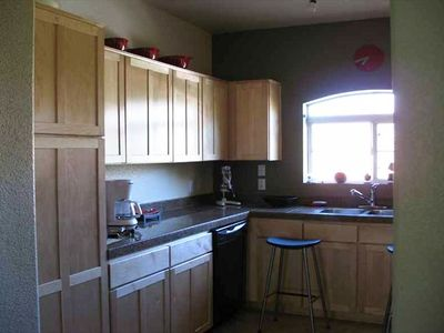 Kitchen -granite counter tops.  Window has Catalina mountain view