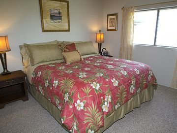 "King bed with pillow top pad in ocean view bedroom. 27"" flat screen TV too!"