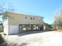 2nd tier location, steps from beach, screened porch, Unobstructed View