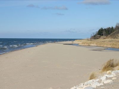 The Lake Michigan beach in Duck Lake State Park: sand, clean water, and dunes.