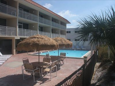 pool area and large covered area with bar under building-you have sun and shade