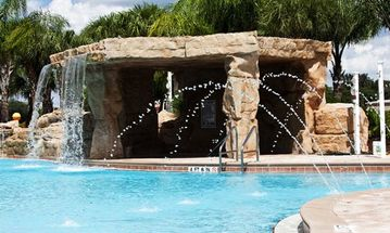 Resort pool and grotto with hot tub