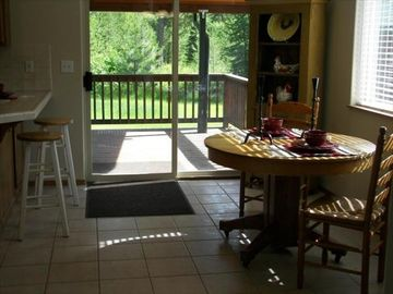 BREAKFAST BAR & DINING ROOM WITH SPACIOUS COVERED DECK GREAT FOR FAMILY BARBEQUE