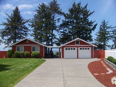 Front Entry with beautifully paved driveway and pass-through view of the sea!