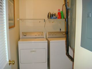 Surfside Beach condo photo - In unit laundry room gives you a place to store your beach items