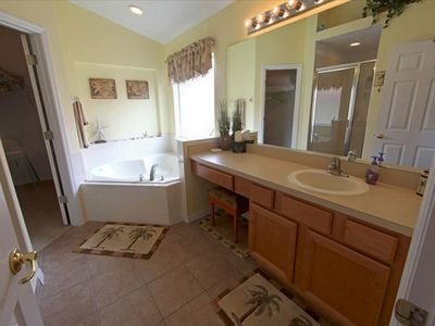 King Suite Bathroom With Garden Tub, Shower, and Private Commode Closet