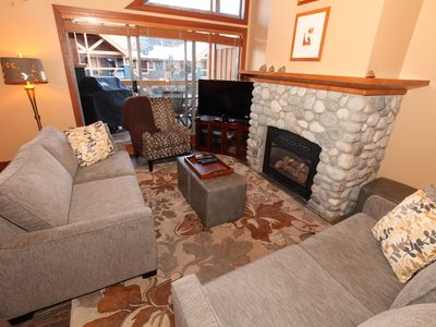 Living room includes a sofa sleeper.  Wonderful stone gas fireplace.
