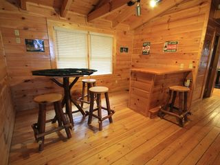 Gatlinburg cabin photo - Very large game area with WiFi, table, stools, wet bar.