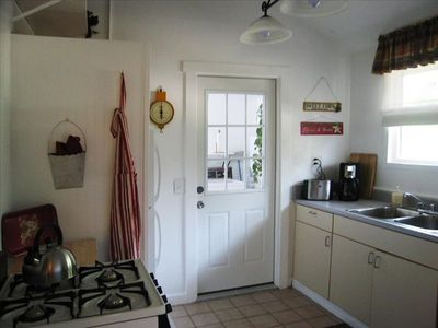 A bright kitchen has everything you need, the door leads to the laundry & pantry