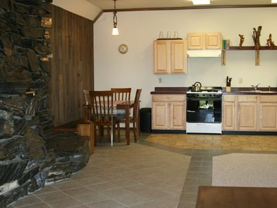 Hide-A-Way rock fireplace and kitchen area