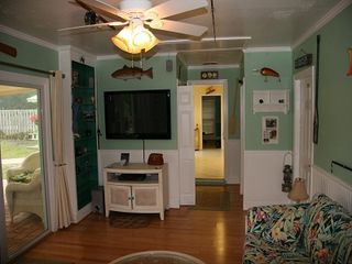 "Anastasia Island house photo - Florida Room with 50"" TV and stereo system. Opens to verandah and pool."