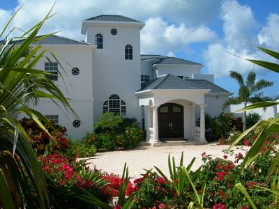 Anguilla castle rental - Castle's entrance flower gardens. Hummingbirds and butterflies visit often.