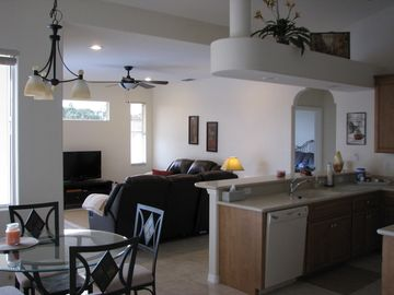 Kitchen & eating area Overlooking the pool Family room with two lazyboy sofas