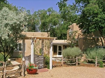 Santa Fe house rental - Front of house. Parking for 4-6 cars in the private drive leading to the home.