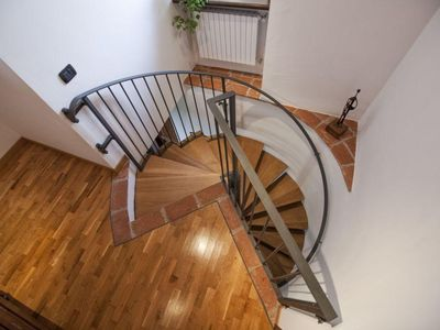 Alba house rental - Spiral staircase connecting the two levels