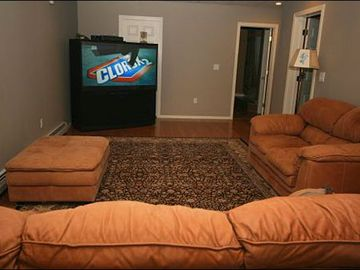 Family Room Features a Plasma TV