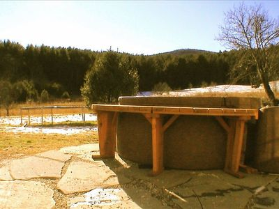 Bondville farmhouse rental - hot tub with view on patio