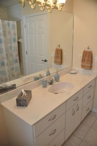 Family bathroom with vanity unit, toilet and shower over bath tub
