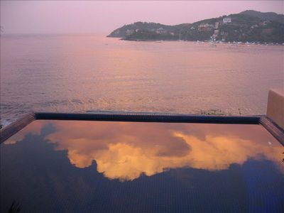 Dawn reflected in the private pool