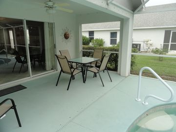 Covered patio area that opens to the pool. Pool has southern exposure!
