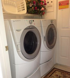 The Laundry room with 'huge' Whirlpool Duet front loading washer and dryer.