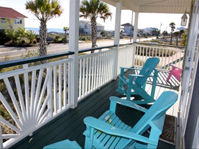 St George Island house rental - View from front covered porch. Notice beach boardwalk to right of yellow home.