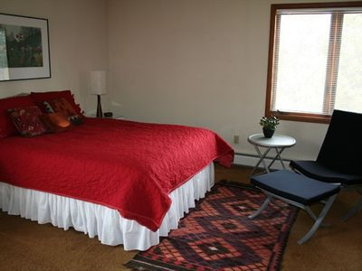 Spacious bedroom on main level with queen bed and private full bathroom