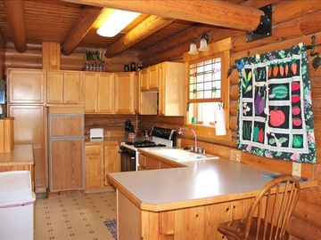 Cook in the fully equipped kitchen or grill on the front porch.