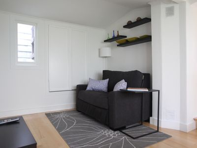 CHARMING ONE BEDROOM IN THE CASTRO'S BEST BLOCK! - Sitting room with flat screen high def 32 inch TV