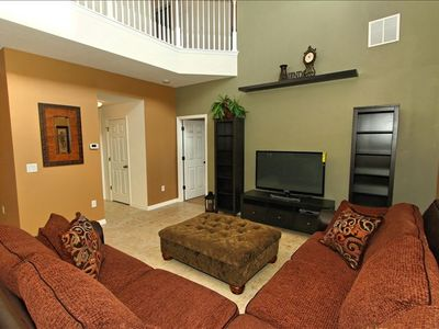 Gather in the large family room near the pool.