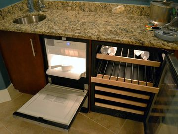 Wet bar with ice machine, wine cooler, sink, powerful ice-crushing blender
