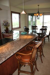 Large breakfast bar in kitchen
