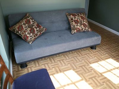 Sofa bed in sunroom.