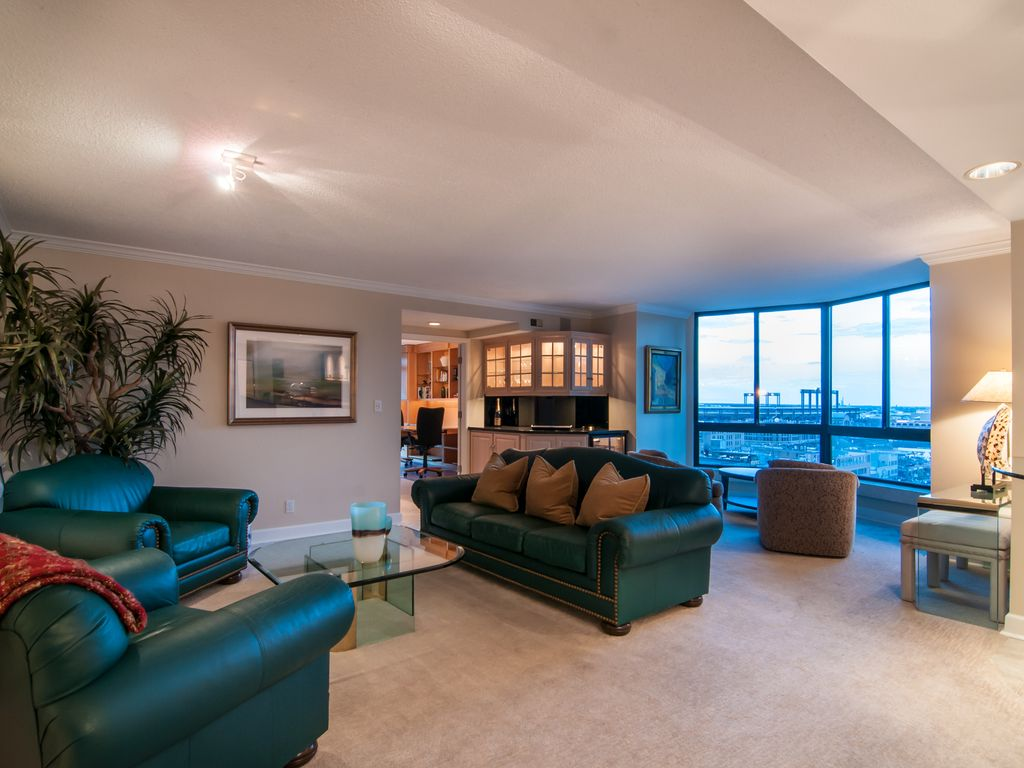 Spectacular views from this open floor plan - living room, dining room & kitchen