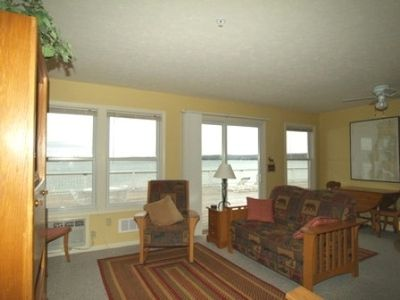 Living Room w/ Loveseat, Rocker, Waterfront Views