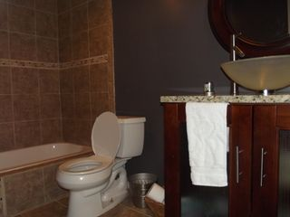 Greenbelt condo photo - Updated Bathroom with ceramic tiles and modern fixtures