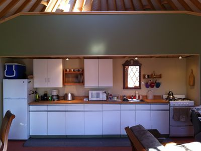 Keene cabin rental - The kitchen has a full fridge, stove, microwave and lots of storage.