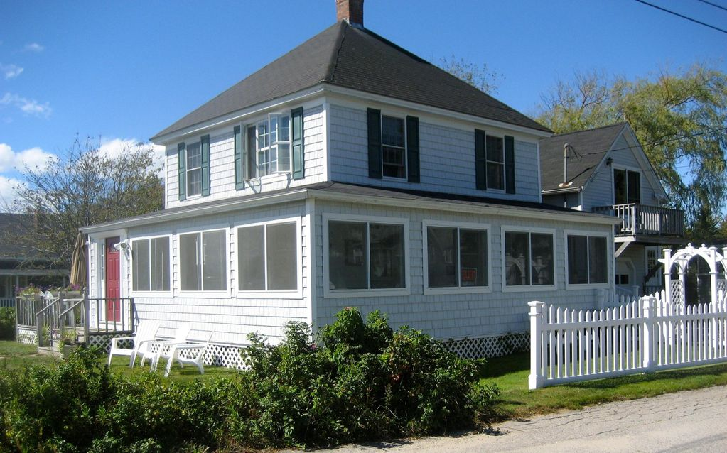 Walk across the street to the beautiful vrbo for Beach house with wrap around porch