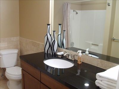 Guest Bath with Tile Floors and Granite Counter Tops
